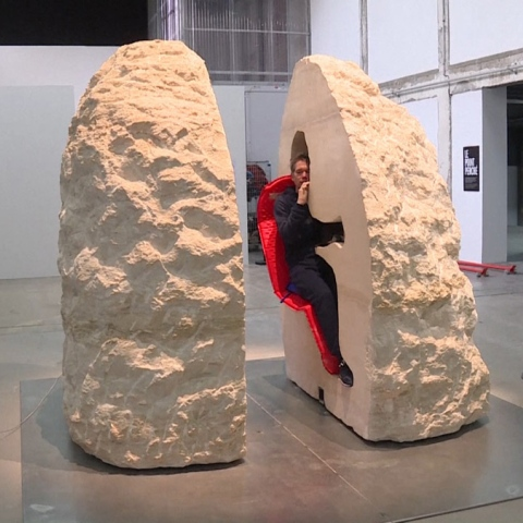 Photo: Artist Entombed in a Hollow Rock